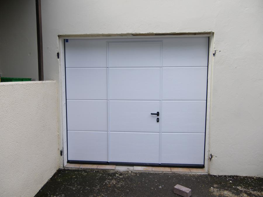 Atoutbaie vannes articles for Porte de garage sectionnelle harmonic avec portillon